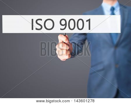 Iso 9001 - Businessman Hand Holding Sign