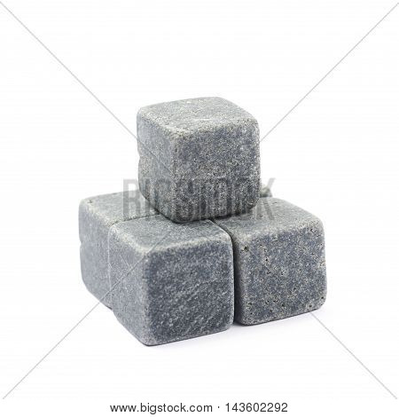 Pile of multiple whiskey cooling stone cubes composition isolated over the white background
