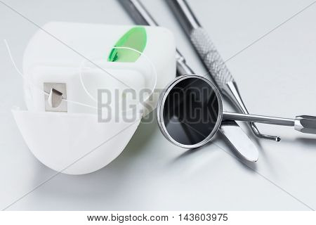 Dental tools for care and treatment of the teeth dental floss mirror trowel and probe concept