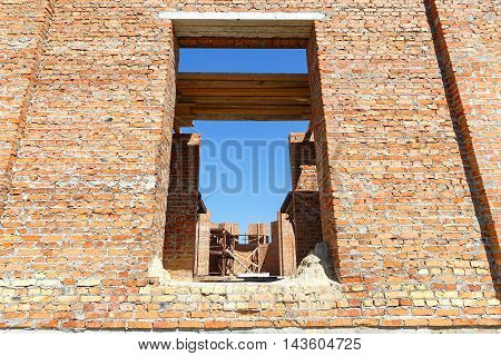 Construction of a brick house. seen through the windows building interior