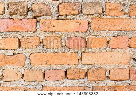 Old brick and crack wall as background texture