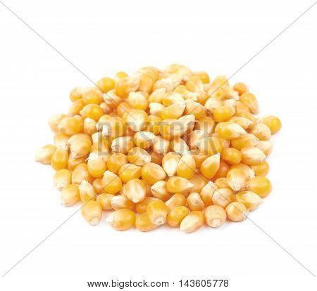 Pile of corn kernels isolated over the white background