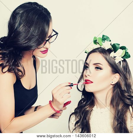 Stage Makeup. Make-up Artist and Beautiful Fashion Model