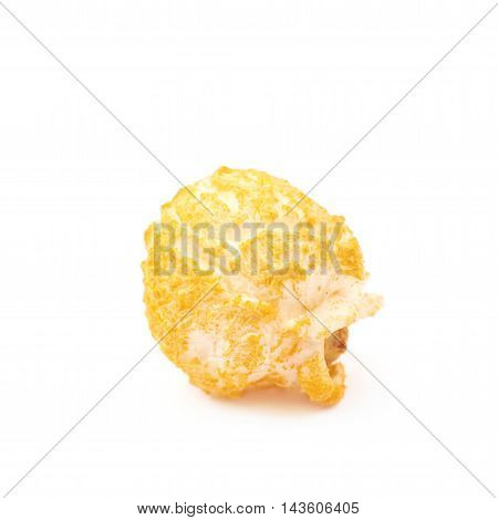 Single cheese flavored orange popcorn flake isolated over the white background