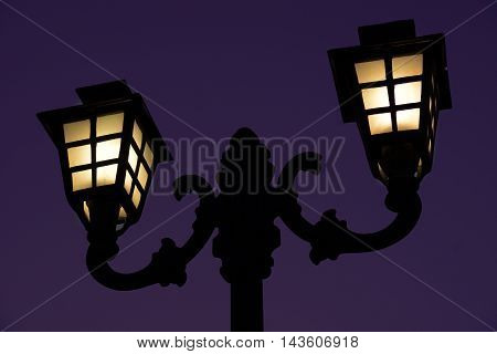 A lamp post of a restaurant in the garden