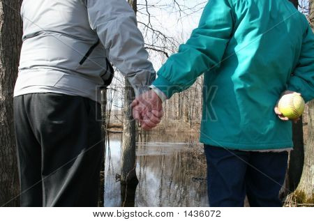 Seniors Holding Hands While Enjoying Nature