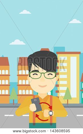 An asian young man holding smartphone and looking at his smart watch. Concept of synchronization between smartwatch and smartphone. Vector flat design illustration. Vertical layout.