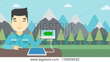 An asian man charging tablet computer with solar panel on the background of mountains. Charging digital tablet from portable solar panel. Vector flat design illustration. Horizontal layout.