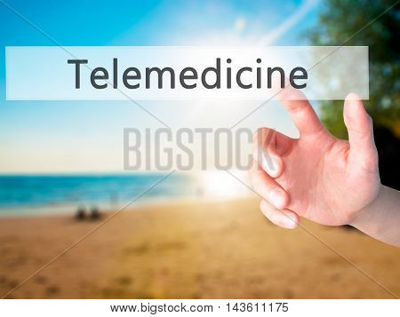 Telemedicine - Hand Pressing A Button On Blurred Background Concept On Visual Screen.