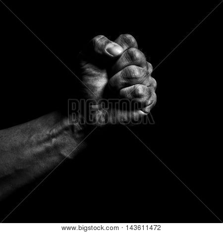 Clenched fist of a man on a black background