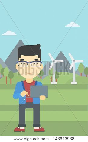 An asian man holding a laptop hands on a background with solar pannels and wind turbins. Man working on computer. Vector flat design illustration. Vertical layout.