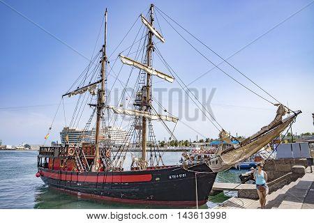BARCELONA SPAIN - JULY 4 2016: Old sailing ship moored at Port Vell in Barcelona.