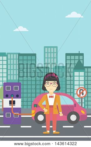 An asian young woman charging electric car at charging station in the city. Woman standing near power supply for electric car charging. Vector flat design illustration. Vertical layout.