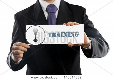 Close up businessman or salesman holding in hands magnifying glass and paper with Training message isolated on white background