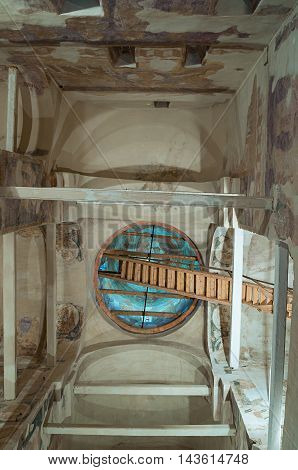 VELIKY NOVGOROD RUSSIA- AUGUST 19 2016.Decorative architecture details- decorated arched ceiling of dome with windows and fresco paintings - inside of Fedor Stratelates on the Brook church