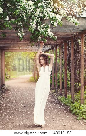Glamorous Woman in Fashionable Dress Posing Outdoors