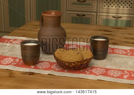 Still life with pottery milk and cookies in the kitchen in the countryside