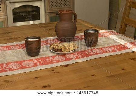 Still life with pottery milk and pipe in the kitchen in the countryside