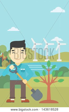 An asian young man plants a tree. Man standing with shovel near newly planted tree. Man planting tree on a background of wind turbines. Vector flat design illustration. Vertical layout.