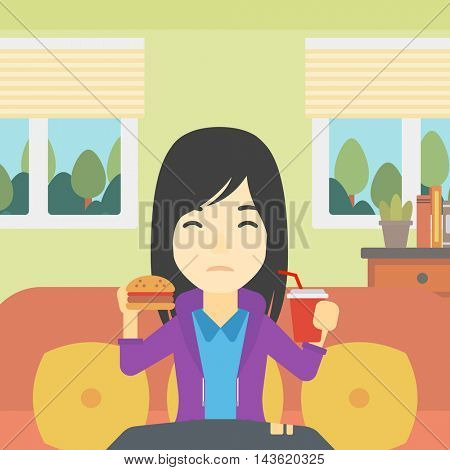 An asian young woman sitting on a sofa while eating hamburger and drinking soda on the background of living room. Vector flat design illustration. Square layout.