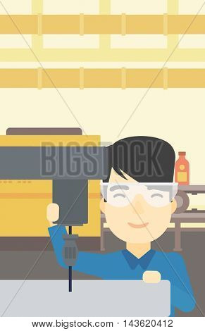 An asian man working on a milling machine at workshop. Man using milling machine at factory. Man making a hole using a milling machine. Vector flat design illustration. Vertical layout.