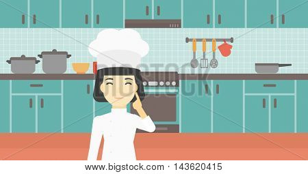 An asian chief-cooker in uniform standing in the kitchen and pointing forefinger up. Chef thinking about the recipe. Chef having an idea. Vector flat design illustration. Horizontal layout.