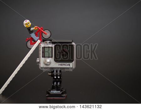 Orvieto Italy - January 17th 2015: . Lego minifigure mountain biker on Gopro Hero4. GoPro is the company that makes the Hero the most popular action cam