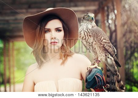 Glamorous Lady in Vintage Hat with Bird