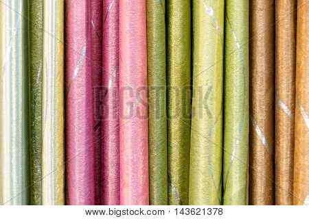 Green pink and brown draped fabric fold for decoration texture background