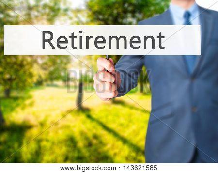 Retirement - Businessman Hand Holding Sign