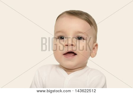 Cute baby boy smiling. Adorable happy laughing baby portrait isolated on white.
