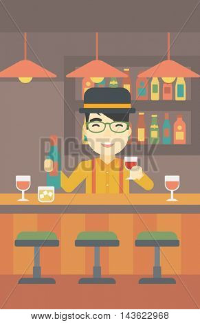 An asian bartender standing at the bar counter. Bartender with a bottle and a glass in hands. Bartender at work. Vector flat design illustration. Vertical layout.