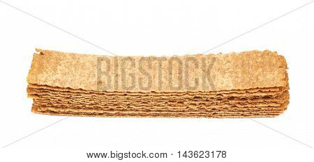 Pile of crispy brown and rectangle shaped bread chips isolated over the white background