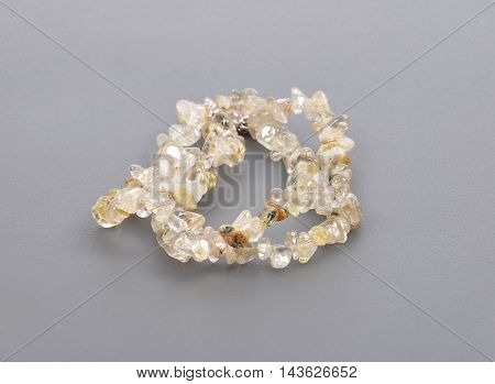 Splintered Rutile Quartz Chain On Gray Background