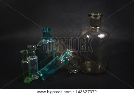Empty Bottles Are Shown On A Dark Background