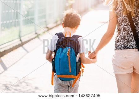 7 Years Old Boy Going To School With His Mother