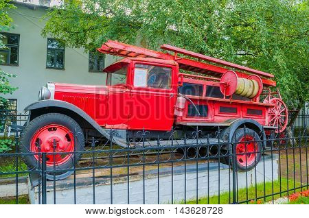 VELIKY NOVGOROD RUSSIA- AUGUST 19 2016. Fire truck standing on the pedestal near the fire department of Veliky Novgorod Russia