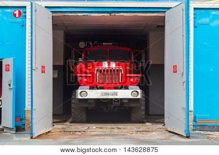 VELIKY NOVGOROD RUSSIA- AUGUST 19 2016. Fire truck standing in the hangar at fire department of Veliky Novgorod Russia