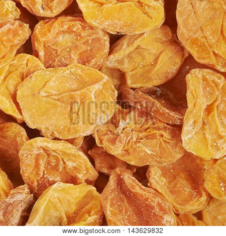 Surface covered with the dried apricot fruits as a food backdrop composition