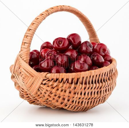 cherry berries in wicker basket isolated on white background cutout