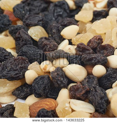 Surface coated with the mix of dried fruits and nuts as a backdrop composition