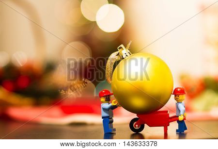 Orvieto, Italy - December 06th 2015: Couple of Lego worker making christmas tree.