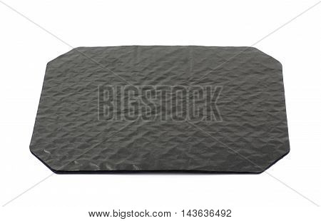 Octagonal sheet of black waxed cardboard paper isolated over the white background