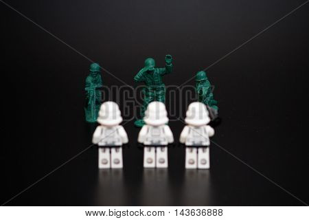 Orvieto Italy - November 22th 2015: Group of Star Wars Lego Stormtroopers minifigures vs. soldier. Focus on soldier. Lego is a popular line of construction toys manufactured by the Lego Group
