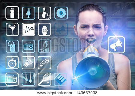 Woman with loudspeaker in sports concept