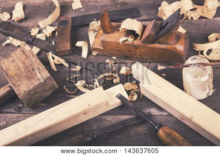 carpentry - vintage woodworking tools on wooden table