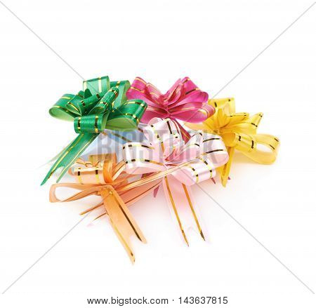 Pile of foldable tape bows isolated over the white background
