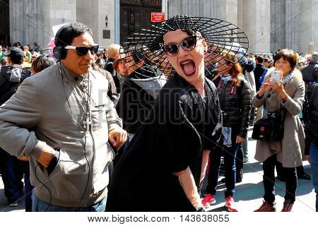 New York City -April 27 2016: Celebrant in an original hat in front of Saint Patrick's Cathedral at the annual Fifth Avenue Easter Parade
