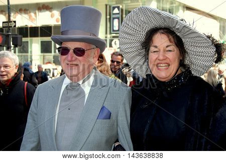 New York City - April 11 2009: Elegant couple dressed in formal vintage clothing at the Easter Parade on Fifth Avenue