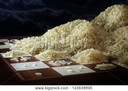 chessboard with growing heaps of rice grains legend metaphor of exponential function and unlimited growth dark sky with copy space selected focus narrow depth of field